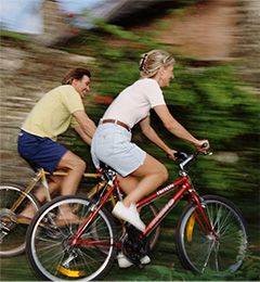 a couple riding a bike